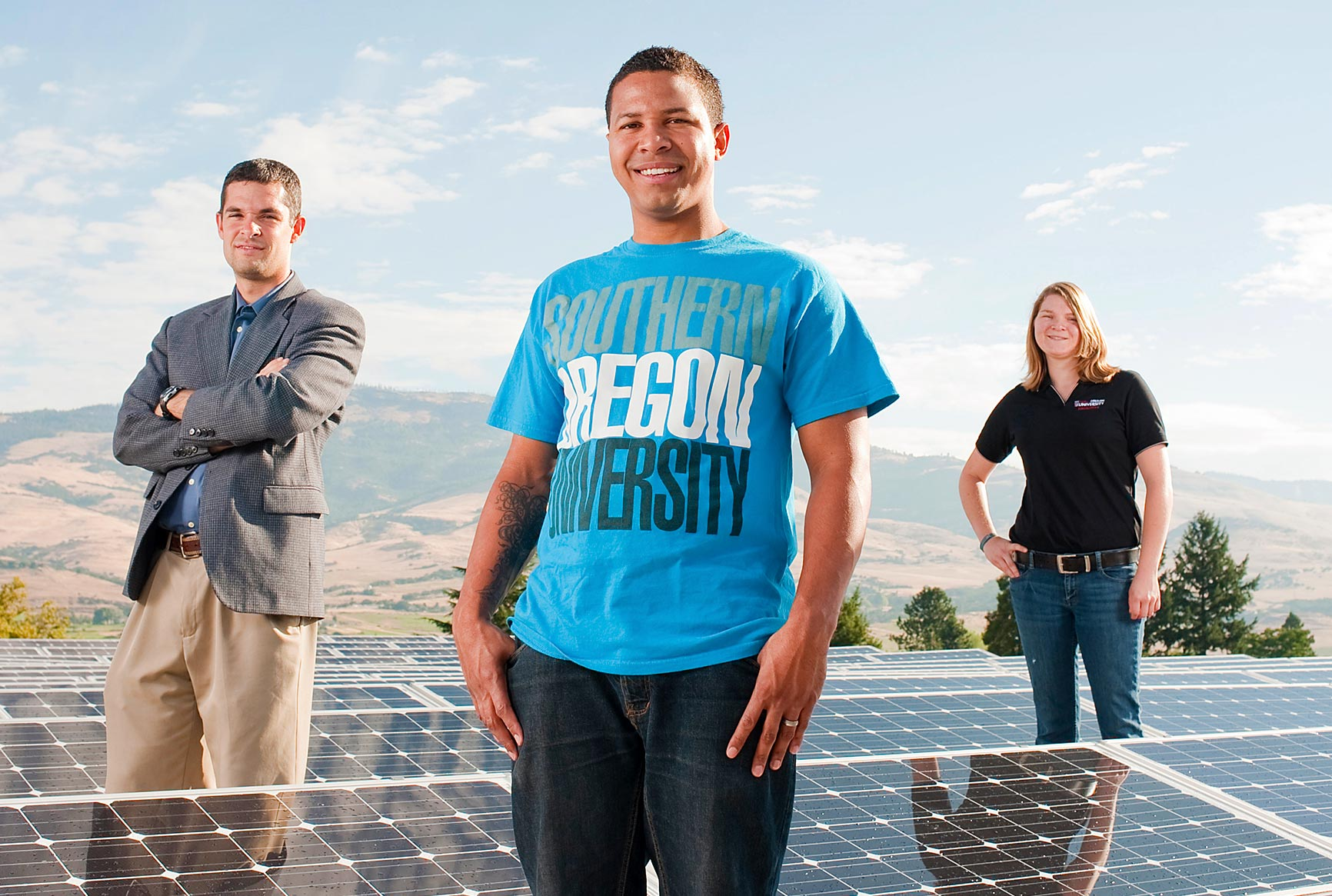 Professors and students standing in front of new solar panels