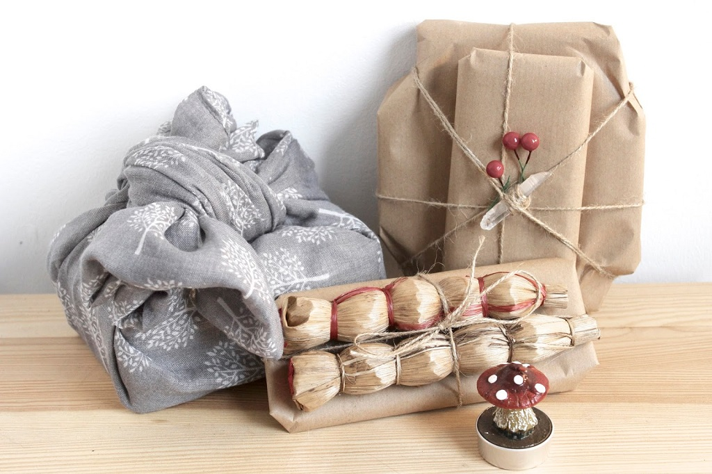 gifts wrapped with zero waste items such as a scarf and scrap paper